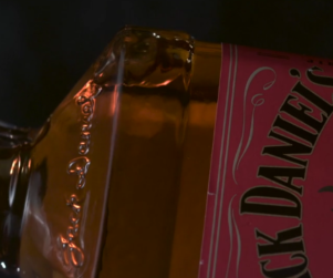 Close up view of a Jack Daniel's Tennessee Fire Whiskey bottle on its side