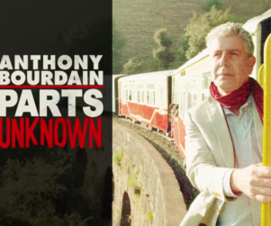CNN original content host Anthony Bourdain on a train with Parts Unknown show graphics and titling